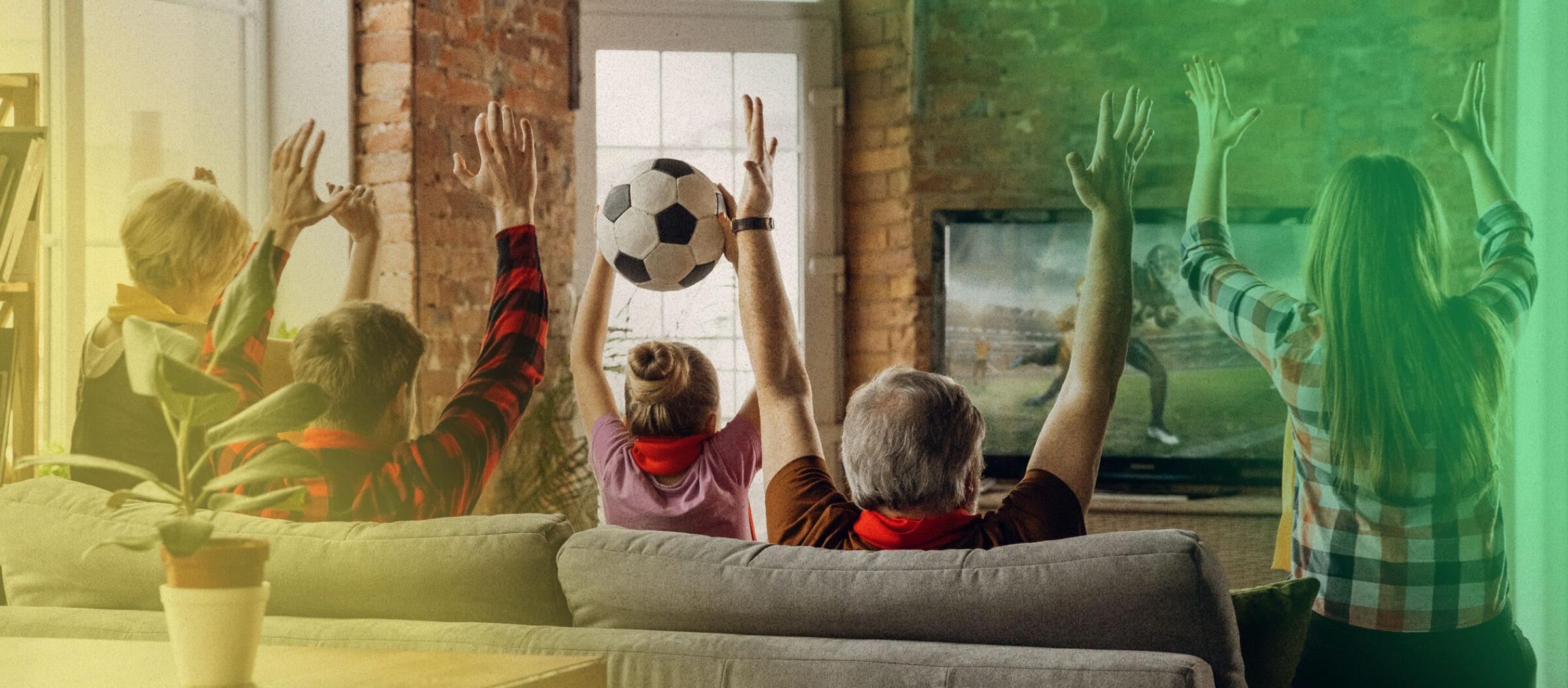 Happy family cheering sport livestream